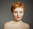 red haired  woman  with  curly haircut