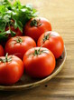 ripe organic tomatoes on a wooden table