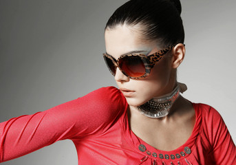 Head shot of woman wearing sunglasses against