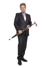 Businessman under an umbrella over white background