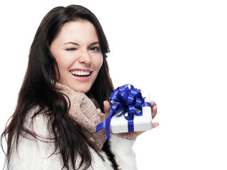 Young lady with gift winks - solated