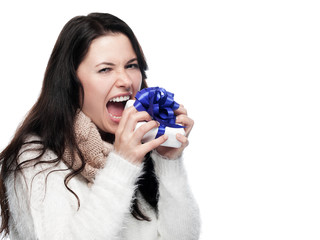 Young woman biting into a gift - isolated
