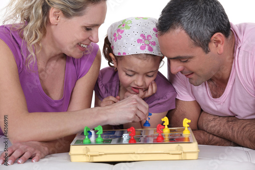Family playing a board game together