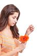 Woman tearing petals