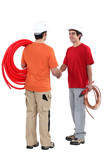 duo of plumbers shaking hands