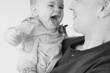laughing baby and dad