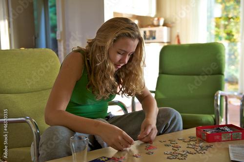 girl puzzling a jigsaw