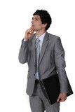 Pensive businessman rubbing his chin