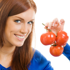 Cheerful woman with tomatoes, over white