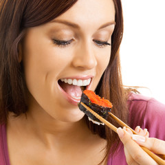 Beautiful woman eating sushi roll, over white