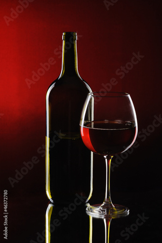 Special red wine bottle with glass