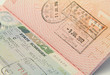 Close up shot of Schengen visa and Hong Kong visa in a passport