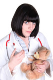 Female doctor injecting a teddy bear