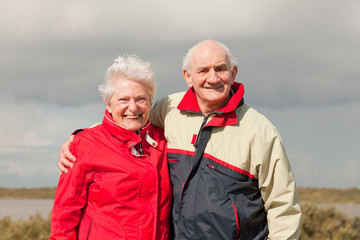 Senior retired couple man and woman enjoying outdoors.