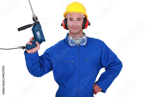 Confident handyman holding power drill