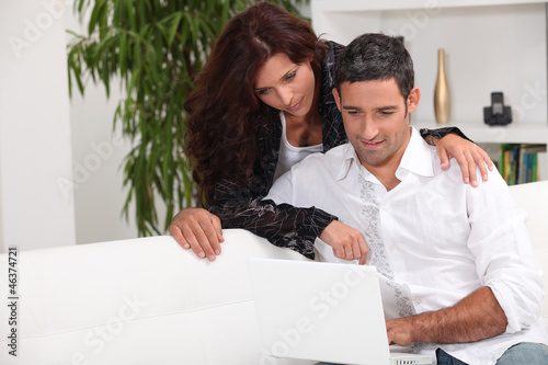 couple surfing on the web