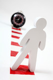 Wooden man standing on chevron with clock in background poster