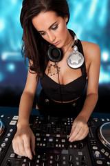 Beautiful busty DJ mixing sound
