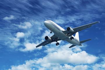 Passenger air plane on blue sky