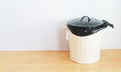 a black plastic bag in reuse disposal bin