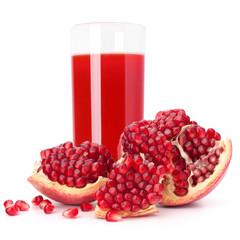 Juice glass and pomegranate fruit