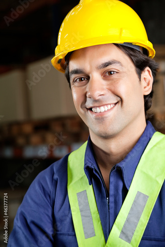 Handsome Foreman Smiling At Warehouse