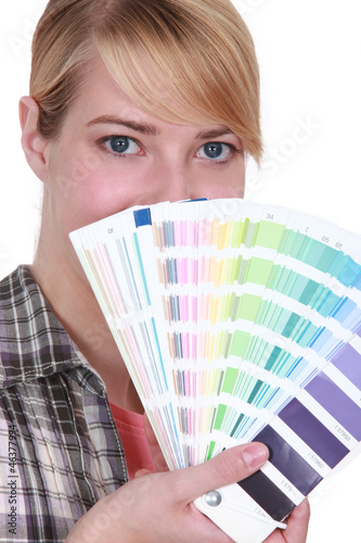 Woman choosing color of paint