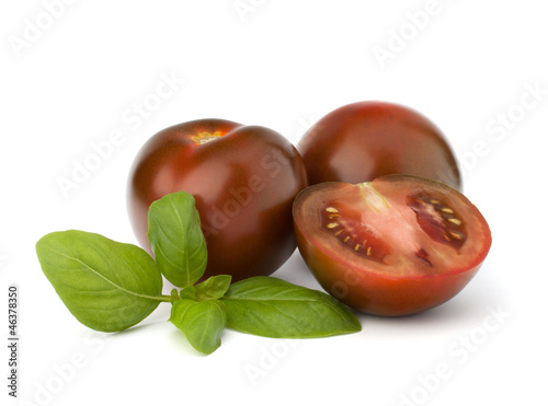 Tomato kumato and basil leaf