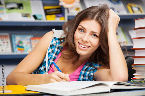 Beautiful female student in a library