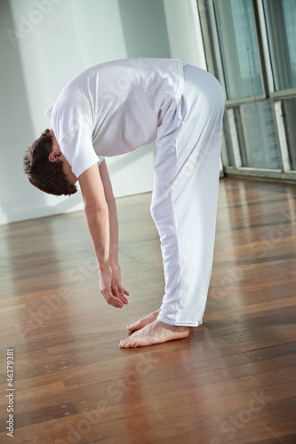 Man Practicing Yoga Exercise