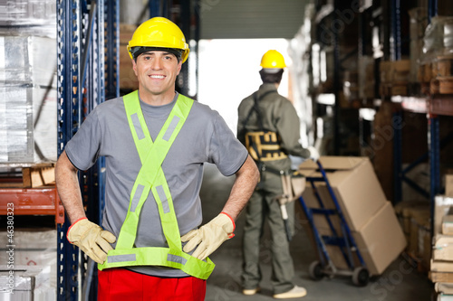 Mid Adult Foreman With Hands On Hips At Warehouse