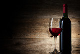 Wine glass and Bottle on a wooden background - 46380792