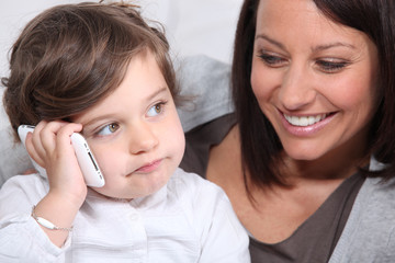 Child playing with his mother's mobile phone