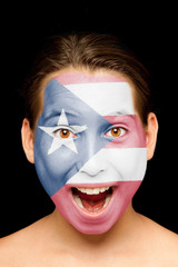 girl with puerto rican flag on her face