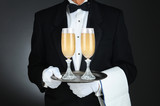 Sommelier with Champagne Glasses on Tray
