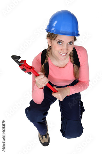 Woman holding wrench