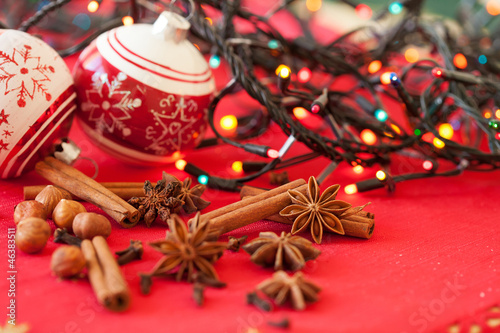 Closeup of spices and Christmas decorations in the background