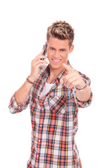 young man on the phone pointing at you