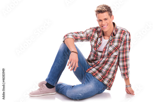 young man sitting and smiling