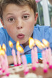 Boy Child Blowing Out Birthday Cake Candles