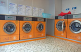 automatic washing machines in a laundromat