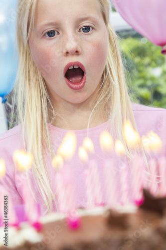 Girl Child Blowing Out Birthday Cake Candles
