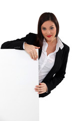 beautiful secretary holding board