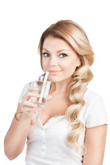 woman in white T-short is holding a glass of water