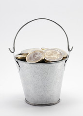 Bucket with euro coins. Clipping path