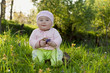 little girl on a background of green grass