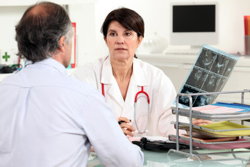 Doctor presenting x-ray results to patient