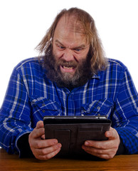 Older man growing frustrated with modern tech