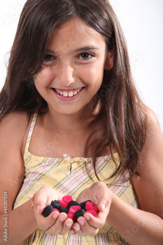 Little girl holding candy
