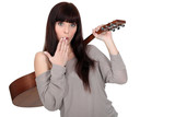 woman carrying guitar over shoulder with hand before mouth